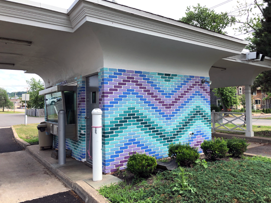 Stephanie Casale is converting the former bank drive-thru on Cayuga Street into an art studio. Her colorful design drew rave reviews from both Mayor Anne Welch and fellow artists at a meeting held on Wednesday.