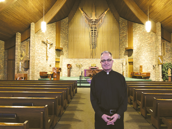 The Rev. Monsignor David LiPuma stands inside St. Peter's R.C. Church, the place he's pastored and called home since 2013. Bishop Richard Malone recently asked LiPuma to shepherd Our Lady of Victory Basilica in Lackawanna.