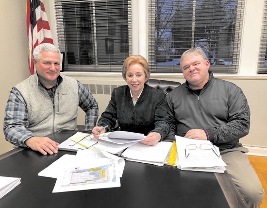 Pictured with Mayor Anne Welch, from Mark Cerrone Inc., are John Toscano, left, and Jeffrey Salvatore.