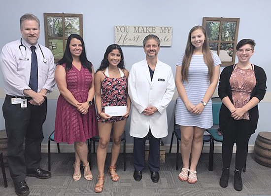 Pictured, from left: Scholarship committee member Shawn P. Ferguson, M.D., pediatrician; Samantha Wardzala, nurse attendant, emergency department; Suhana Monsalve of Lewiston Porter High School; Dr. Thomas Cumbo, chief medical officer, and a member of the scholarship committee; Hannah Anderson, Lockport High School; and Kamryn Smith, Niagara Falls High School. Not shown: Lindsay Kancar of Niagara-Wheatfield High School.