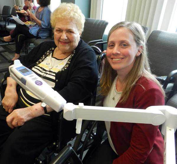 In the photo, DiMino, left, poses with Jessica Visser, vice president of patient care services.
