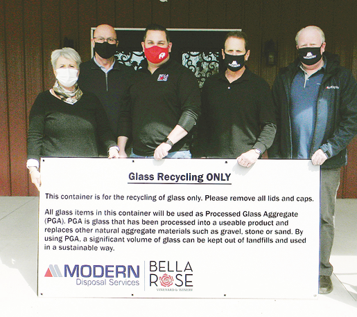 From left, 1st District Niagara County Legislator Irene Myers joins with Modern CEO Michael McInerney, Bella Rose Winery's Michael Schweitzer, Modern Vice President of Operations Robert Trunzo and Vice President of Post Collections, Operations and Sales Al Davis in announcing a new wine bottle recycling effort.