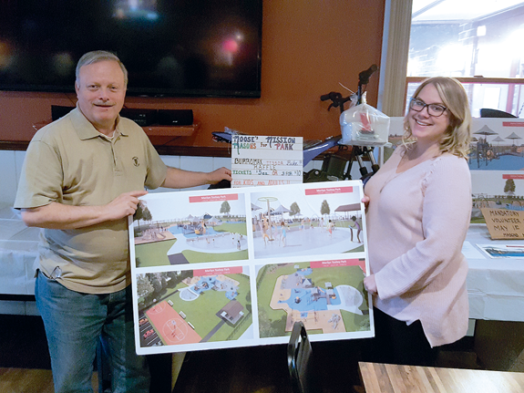 Village of Lewiston Trustee and Moose Lodge officer Vic Eydt is shown with Stephanie Myers, village deputy treasurer and a Moose Lodge staffer. They're holding an artist's renderings of the Mason's Mission Playground at Marilyn Toohey Park. Readers are invited to be a part of the Aug. 3 `Moose's Mission` benefit at Academy Park. (Photo by Terry Duffy)