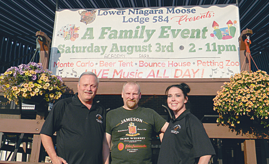 In the photo, from left, Moose's Mission organizers Vic Eydt, Josh Kilmer and Ashley Olds. (Photo by Terry Duffy)