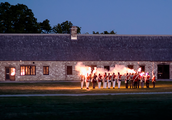 The `War of 1812 Encampment` features a unique evening battle on Saturday, Aug. 31, demonstrating how the British made a surprise attack on the fort in December 2013. The Mackenzie Highlanders open up the evening program with lively bagpipes and drums. One must arrive before 7 p.m. to get tickets for the evening program. (Photo by Wayne Peters)