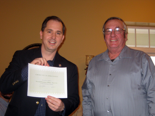 Assemblyman Mike Norris accepts a certificate from Niagara County Farm Bureau President Jim Bittner.