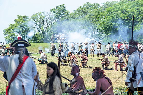 At 2 p.m. daily, large-scale battle re-enactments will boom at Old Fort Niagara during the 40th anniversary of the French and Indian War Encampment. Be sure to arrive at least 30 minutes early for the best viewing options. (Photos by Wayne Peters)