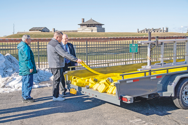 Gregg Robertson of Youngstown Volunteer Fire Co. discusses the features of the new apparatus with Old Fort Niagara Executive Director Robert Emerson. The fire trailer is designed to handle accessibility issues inside the OFN walls. (Photos by Terry Duffy and Wayne Peters)