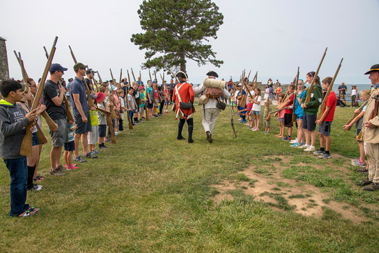 Meeting and talking to re-enactors is always a highlight at Old Fort Niagara events. At `Soldiers of the Revolution,` visitors can interact with British, Native and colonial American settlers in their camps. Music and games also are fun additions to the re-enactment activities. (Photos by Wayne Peters)