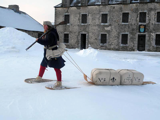 A French-Canadian militiaman pulls his supplies on a toboggan, known as a traine. `Winter Warriors` will demonstrate how soldiers carried supplies through the winter woods during the 17th and 18th centuries.