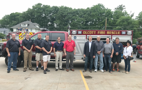 New York State Sen. Rob Ortt (suit coat) stands with members of the Olcott Fire Co.