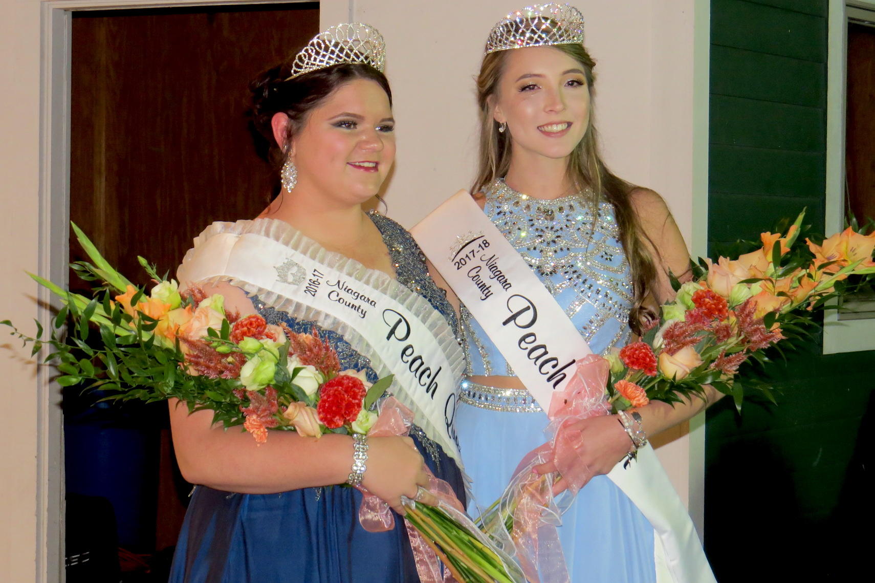 Outgoing Peach Queen Angelica Beiter stands with the new Peach Queen, Jamie Hagerty. (Photo by Lauren Garabedian)