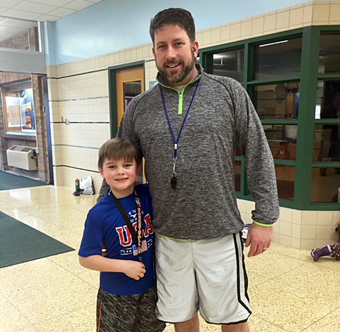 David Perreault with Julian, a participant in the basketball program.