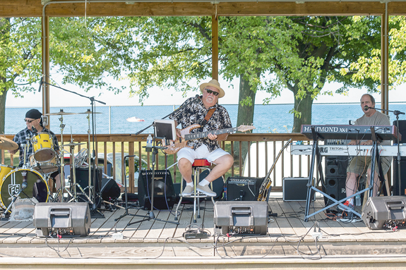 Expect tasty foods, craft vendors, children's activities, entertainment, games and more at the Town of Porter Summerfest, next Saturday at Porter on the Lake park. Shown are scenes from a recent Summerfest. (File photos)