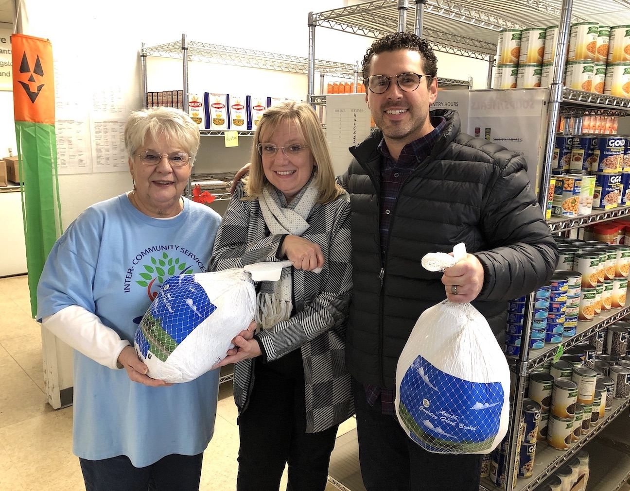 Pictured, from left, at Ransomville Care-n-Share Food Pantry, are Operations Manager Ellie Murphy, board member Lori Adamson, and Michael Hibbard of Gallo Coal Fire Kitchen. Hibbard spearheaded a fundraiser to ensure families in need would receive a Thanksgiving turkey.