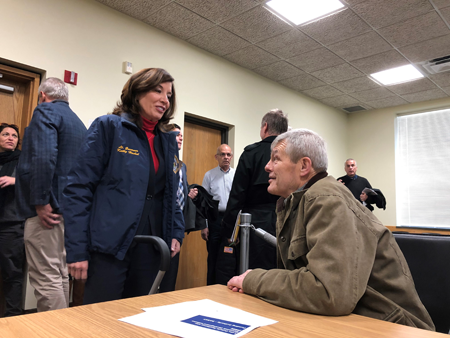 Lt. Gov. Kathy Hochul and Newfane Supervisor Timothy Horanburg discuss the shoreline resiliency projects at a meeting of the Niagara and Orleans REDI Region Planning Committee. (Photo courtesy of NYSDEC)