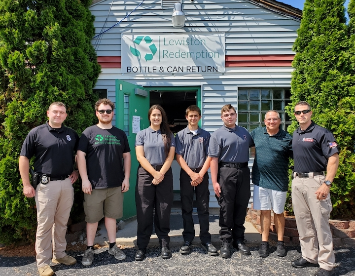 Pictured, from left: LPD officer Brandon Comerford; Lewiston Redemption manager Matt Bohn; Explorers Sarah Pitts, Carl Russo and Ryan Shanor; owner Bill Schiavitti; and officer Brandon Hall.