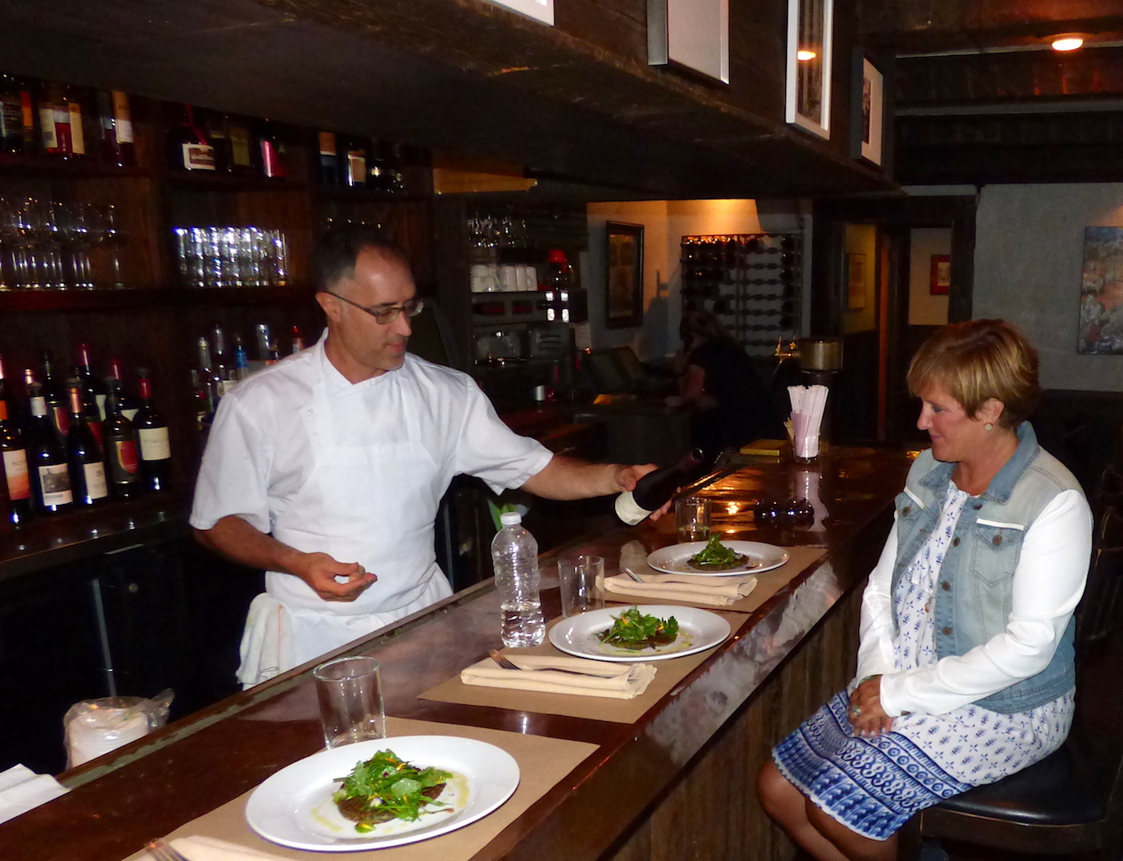 Chef Carmelo Raimondi serves a Roaming Tour tasting to Karen Merkel inside Carmelo's Restaurant in Lewiston.