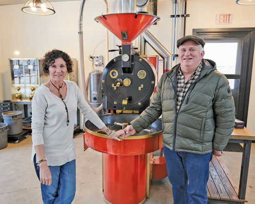 Kate and Sean Edwards stand by their roaster in Sanborn (Photo by Mark Williams)