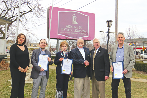 The Lewiston-Porter Sentinel received a special Niagara County Legislature proclamation for its 30th anniversary. Pictured, from left, are Niagara River Region Chamber of Commerce President Jennifer Pauly, NFP Managing Editor Joshua Maloni, owner Judy Mazenauer, Legislator Clyde Burmaster, owner and Publisher Skip Mazenauer, and Editor-in-Chief Terry Duffy. (File photo)