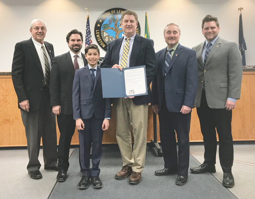 Lew-Port student Simon Zawistowski, shown with Town Supervisor Steve Broderick, Town Board members and VFW Downriver Post 7487 members Bill Justyk, Vince Canosa, Harry Raby and Larry Stephens, at a Monday presentation recognizing his winning essay. (Submitted photo)