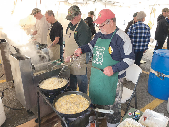 Niagara River Anglers Association members cook smelt at the 2018 Lewiston festival.