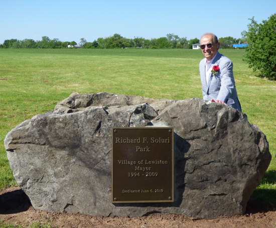 Former Village of Lewiston Mayor Richard Soluri stands next to the marker in his honor at the plateau.