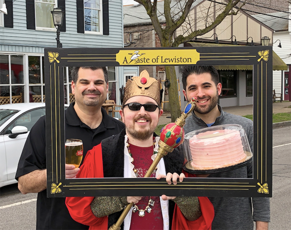 A Taste of Lewiston King Joshua Maloni is shown alongside Chuck Barber of Apple Granny and Michael Fiore of The Village Bake Shoppe. The popular foodie fest returns to Lewiston on May 25.