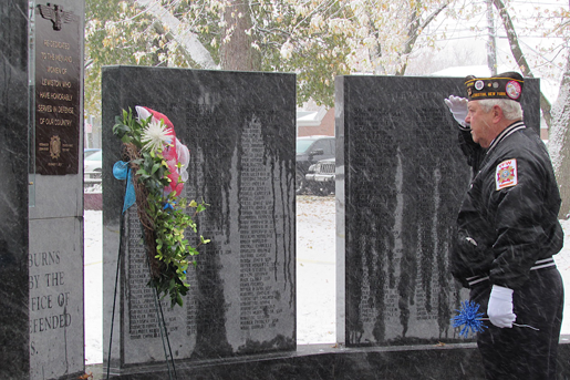 Harry Raby salutes the memorial wreath in 2019. (File photo)