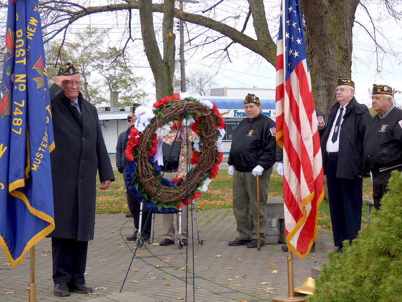 American Legion C.C. Kenney Lewiston Post 1083 Cmdr. Robert Hall salutes the memorial wreath on Veterans Day.