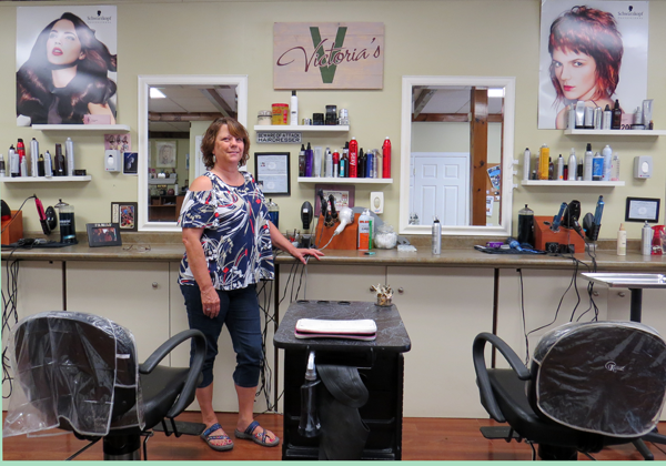 Vicky Quarantillo stands inside her Youngstown salon.