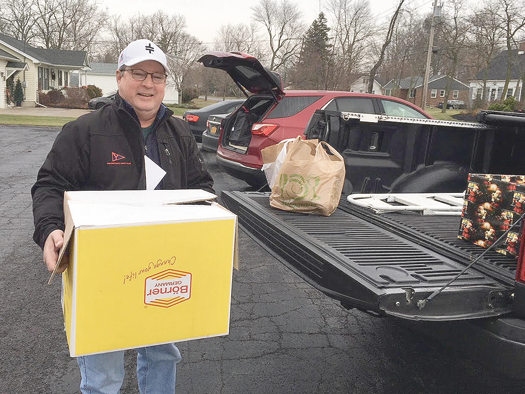 Volunteer Paul Hayes helps to deliver food boxes and gift bags to needy families. (Submitted photo)