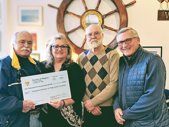 1st District Niagara County Legislator Clyde Burmaster, Cheryl Butera, YBPA president; Jerry Brett, YBPA vice president; and Mark Butera, YBPA secretary, at last week's $1,500 check presentation. (Submitted photo)