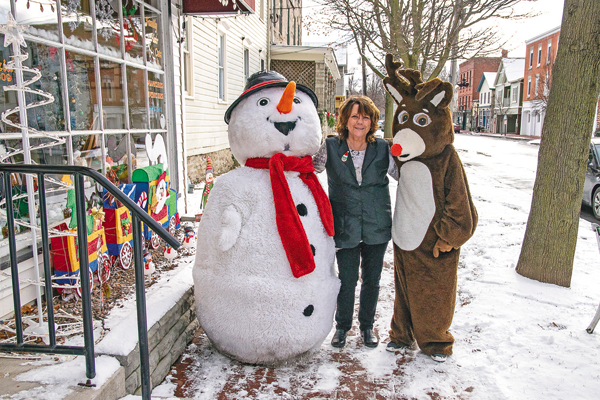 In the photos are scenes from last year's Christmas in the Village. (File photos)