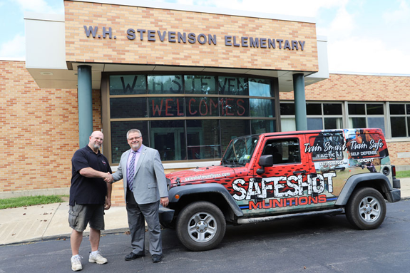 SafeShot Munitions LLC General Manager Stephen Cliffe and Wilson Superintendent Tim Carter.