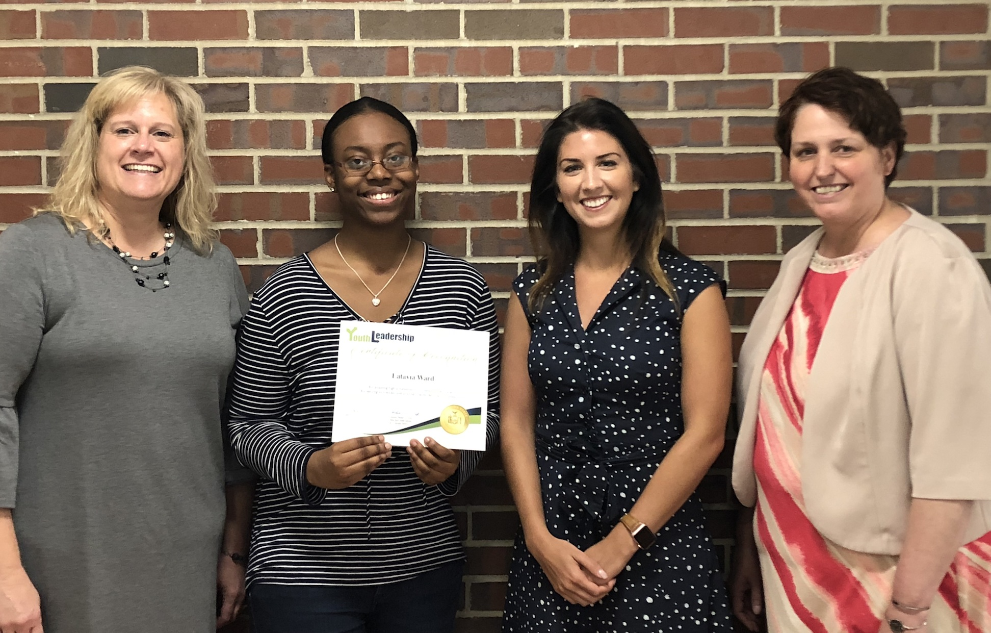 From left, Laura Koeppel, Latavia Ward, Madeline Genovese and Niagara Career and Tech Ed Center Principal Leslie Tanner.
