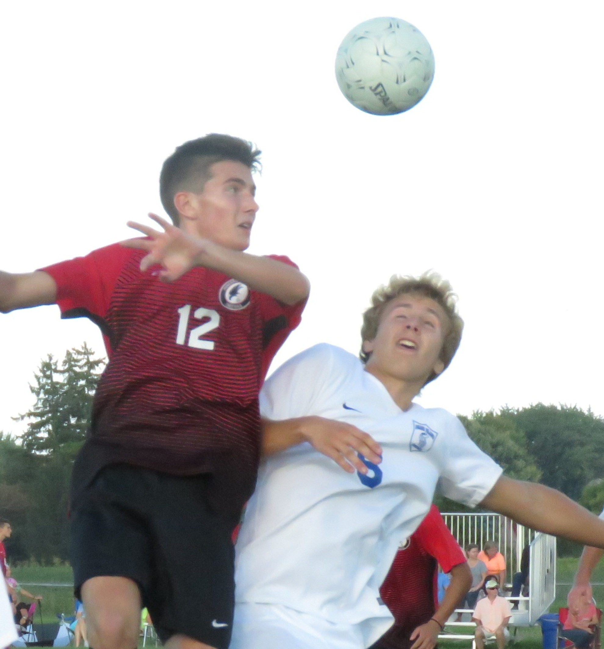 Niagara-Wheatfield's Jacob Vallas, left, looks to head the ball as he's defended by Grand Island's Ken Carter. (Photos by David Yarger)
