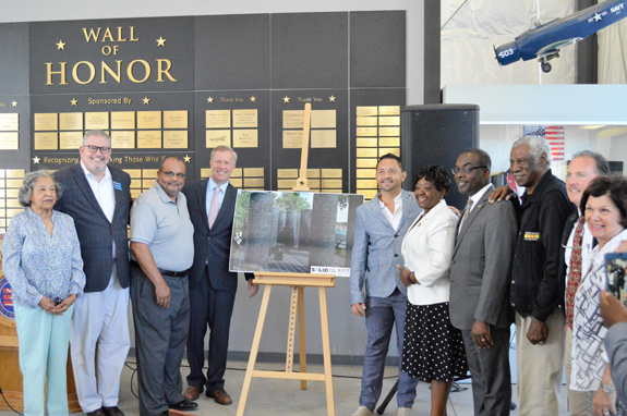From left: Madeline Scott, African-American Veterans Monument committee; Terry McGuire, board chair, Buffalo & Erie County Naval & Military Park; Warren Galloway, chair, African-American Veterans Monument committee; Sen. Chris Jacobs; monument designer Jonathan Casey; Assemblywoman Crystal Peoples-Stokes; Mayor Byron W. Brown; Ronal Bassham, African-American Veterans Monument committee; Paul Marzello, director, Buffalo & Erie County Naval & Military Park; and Marina Woolcock, board member, Buffalo & Erie County Naval & Military Park.
