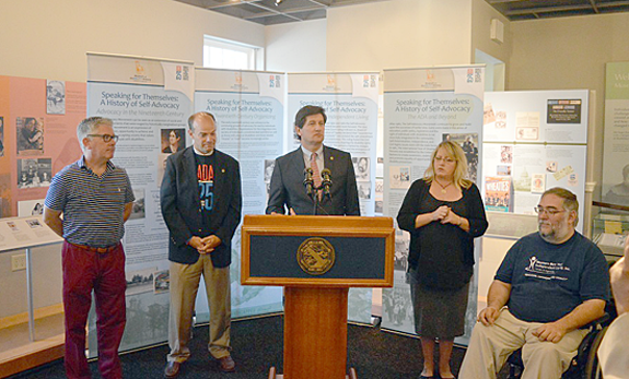Erie County Executive Mark C. Poloncarz (at podium) is joined by (from left) Kevin Horrigan of People Inc., Executive Director of the Erie County Office for the Disabled Frank Cammarata, Andrea Russell of Deaf Access Services, and Todd Vaarwerk of WNY Independent Living Inc. at the Museum of disABILITY History in Buffalo to celebrate the 28th anniversary of the passage of the Americans with Disabilities Act.