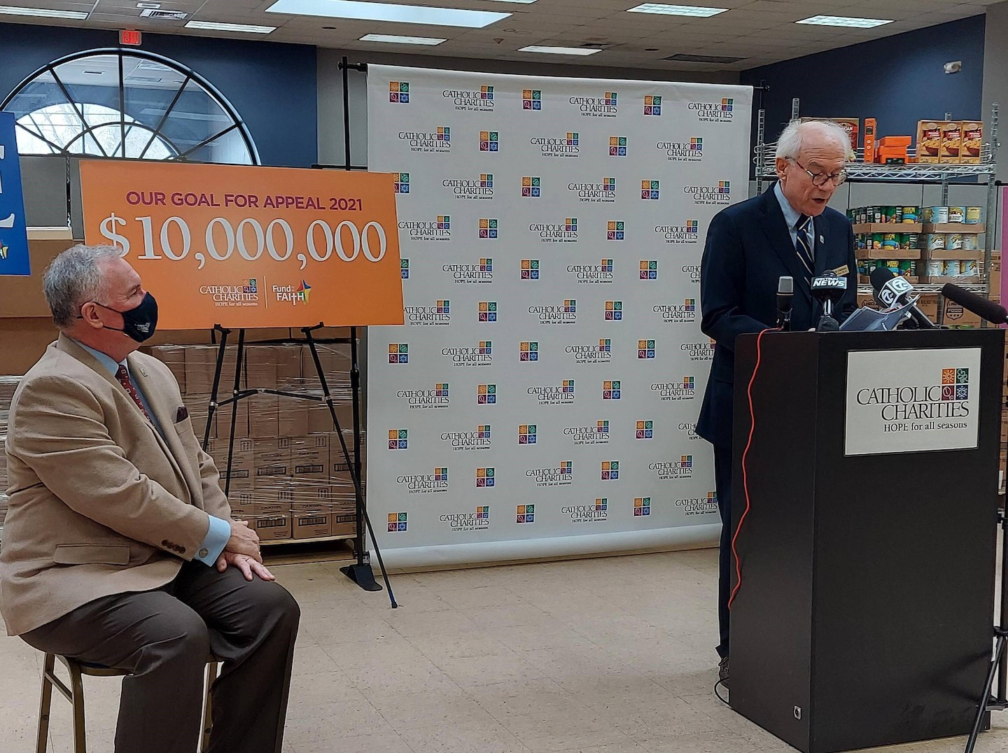 Deacon Steve Schumer, president and CEO of Catholic Charities, with Rick Cronin, Appeal 2021 chair, announcing the $10 million goal