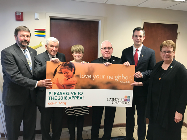 From left: CEO Dennis C. Walczyk, 2018 Appeal Chair Robert M. Bennett, Appeal Co-Chair Maurine Falkowski, Bishop Richard J. Malone, Appeal Co-Chair Andrew Bennett and Diocesan Director Sister Mary McCarrick.