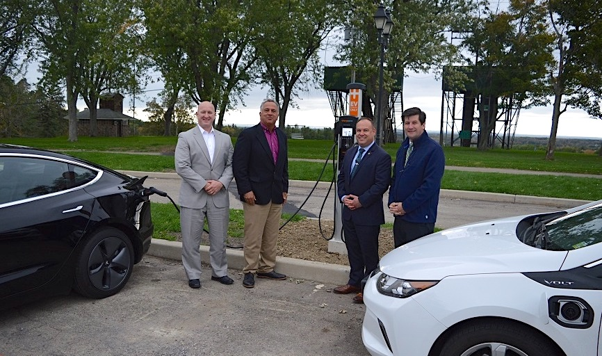 Erie County Executive Mark Poloncarz (at right) is joined by, from left, Craig Jackson of Clean Communities of WNY, Tony Hazzan of NYSERDA, and Erie County Public Works Commissioner Bill Geary at Chestnut Ridge Park in front of the park's new dual-port electric vehicle-charging station, located near the casino.