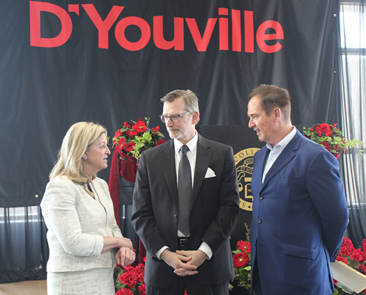 Pictured with Congressman Brian Higgins are D'Youville College President Lorrie Clem and `CJ` Urlaub, past chairman of the board of trustees, president and CEO of Mercy Hospital.