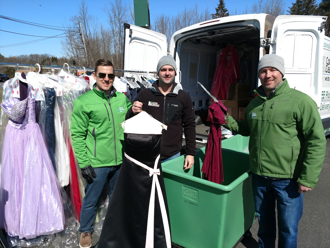 Vice President of Colvin Cleaners Chris Billoni and volunteers collecting gowns at the Orchard Park location.