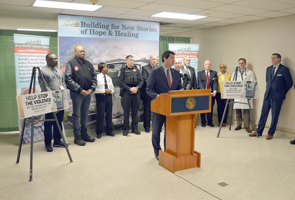 Erie County Executive Mark Poloncarz (at podium) is joined by elected officials, law enforcement officials, ECMC staff, community members and members of the Crime Stoppers board to announce a new initiative to reduce fatal and nonfatal shootings in Erie County.
