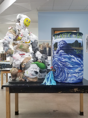 An example of both a rain barrel and a plastic bag sculpture by Adam Rivers' AP art class at Buffalo Academy of Science High School. (Submitted photo)