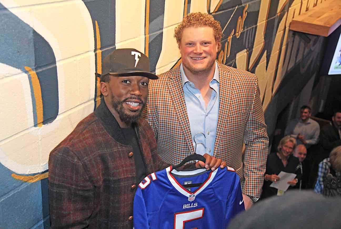 Tyrod Taylor and Eric Wood; Wood is also shown below with guests.