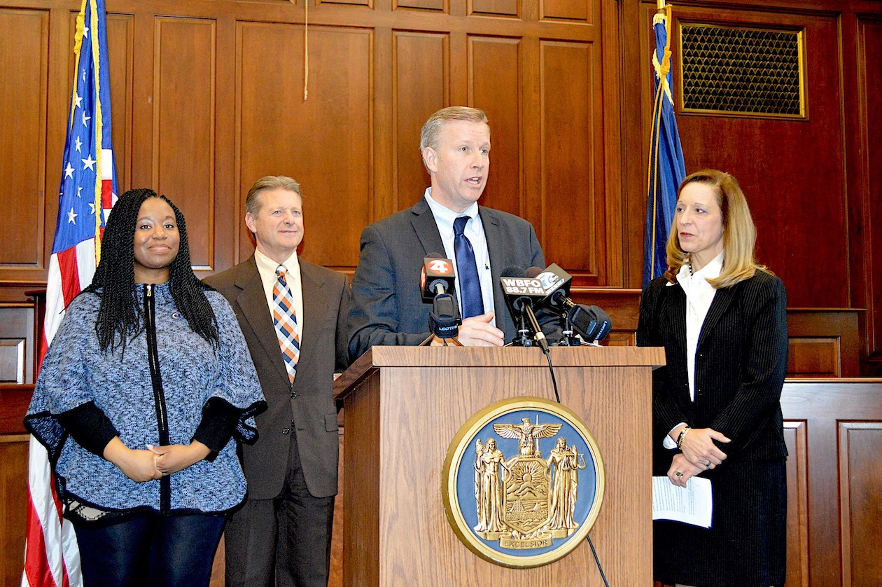 Sen. Chris Jacobs speaks in support of $2 million in funding for the facilitated enrollment childcare subsidy program with, from left, working mom Brianna Harris, Sen. Pat Gallivan and WNY Women's Foundation Executive Director Sheri Scavone.