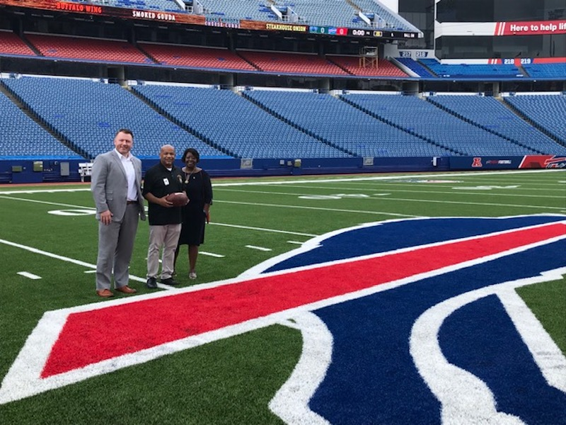 Pictured with Speaker Carl Heastie at New Era Field, from left: Assemblyman Pat Burke and Assembly Majority Leader Crystal Peoples-Stokes.