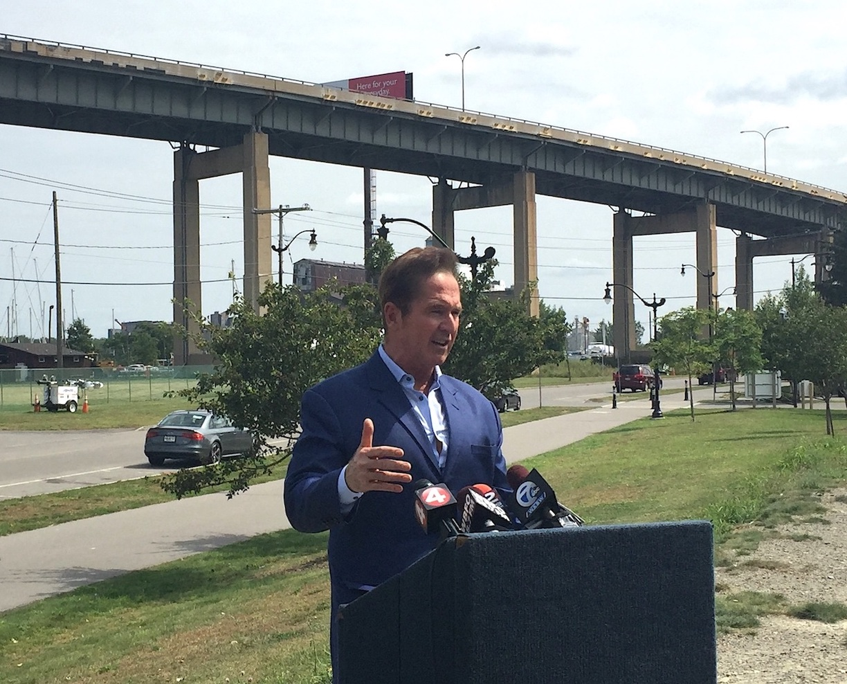 Congressman Brian Higgins addresses the media, standing below the Buffalo Skyway, in this file photo.